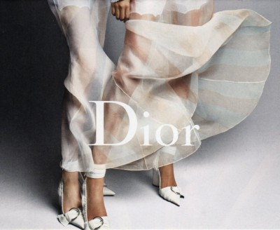 A Dior ad featuring two models, both wearing billowy attire.