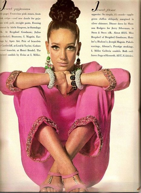 An Irving Penn photo of Marisa Berenson, who is wearing a pink outfit